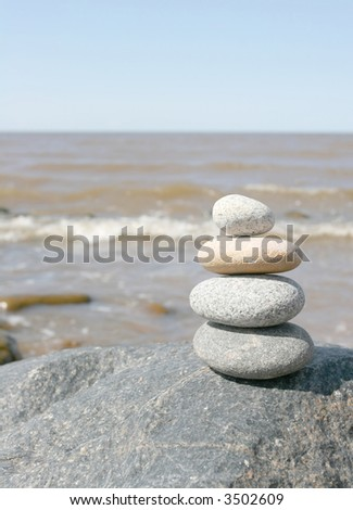 Stone stack against the blue sky - stock photo