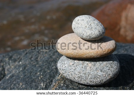 Stone stack near the sea - stock photo
