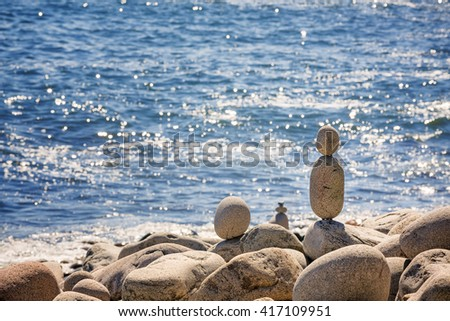 Stone stacks on Boulder Beach, Acadia National Park, Maine, USA. Space for your text. - stock photo