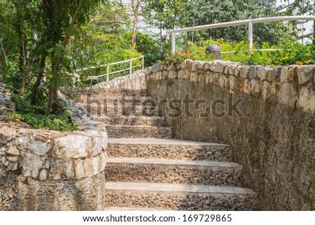 Stone staircase  in garden - stock photo