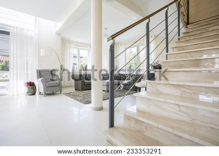 Stone staircase placed in modern living room - stock photo