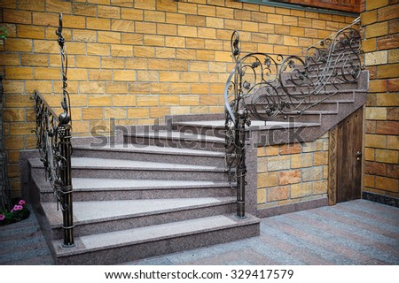 Stone staircase placed in modern living room. - stock photo