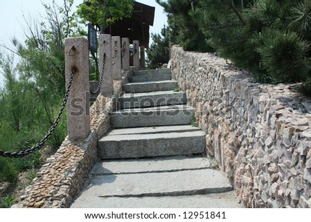 Stone Staircase to the top of success - stock photo