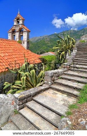 Stone stairs along traditional building of an orthodox church from the Mediterranean sea area, Montenegro - stock photo