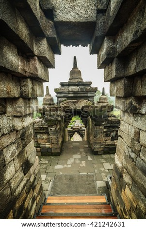 Stone stairs and passages in the Temple Borobudur at Sunrise. Yogyakarta, Indonesia. - stock photo