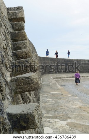 Stone stairs at Cobb in Lyme Regis, Dorset - stock photo