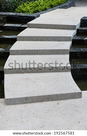 Stone stairs in the garden - stock photo