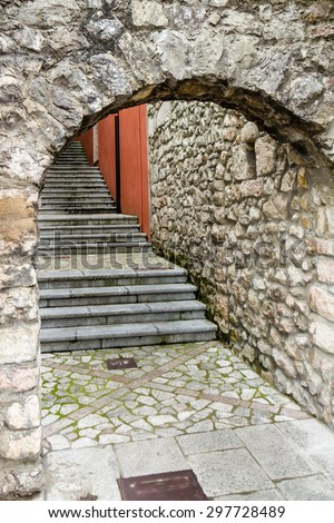 Stone stairs killed in a stone arch in a beautiful city  - stock photo