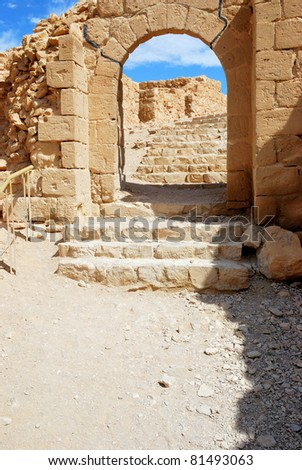 Stone stairs leading up to ancient fortress Masada, Israel. - stock photo