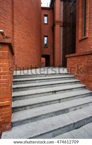 Stone stairs passage and brick wall in an old brewery in Poznan