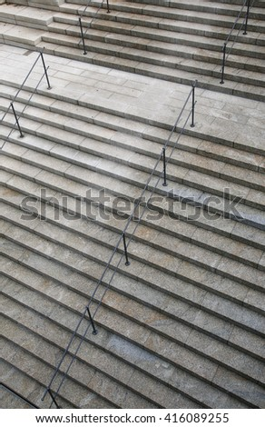 Stone stairs pattern with railing - stock photo