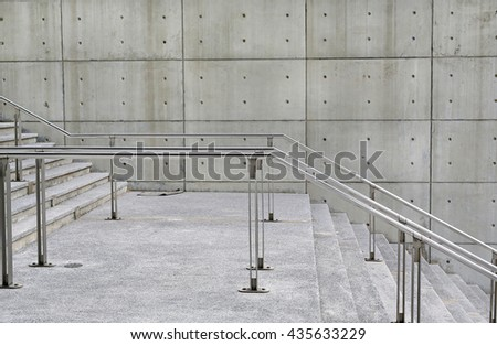 Stone stairs steps background with aluminium handle - stock photo