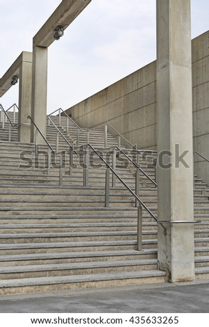 Stone stairs steps background with aluminium handle