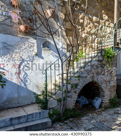 Stone stairs with arched niche downstairs in the courtyard of the old house in Jerusalem