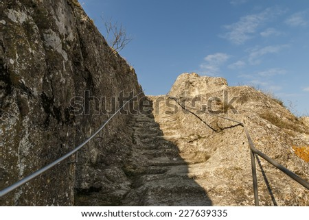 Stone stairs with beautiful blue cloudy sky - stock photo