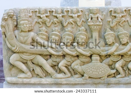 stone statue Angkor Wat styles,Pulling against the Naga serpent - stock photo