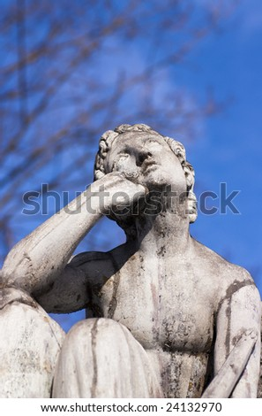 Stone statue, man deep in thought