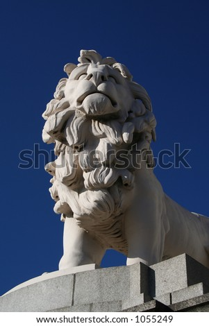 Stone statue of a lion - stock photo