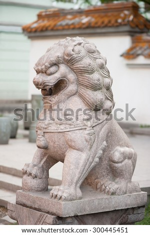 Stone statue of asian lion - stock photo