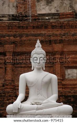 Stone statue of Buddha in the temple of Wat Yai Chai Mongkol in Ayutthaya, Thailand - stock photo