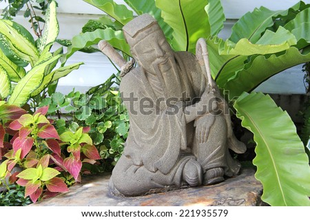 Stone statue of Confucius - stock photo