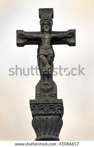 stone statue of jesus on the cross - stock photo