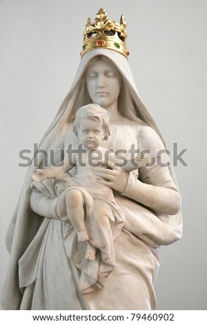 Stone statue of Madonna with Child - stock photo