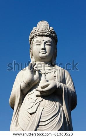 Stone statue of the Buddha - stock photo