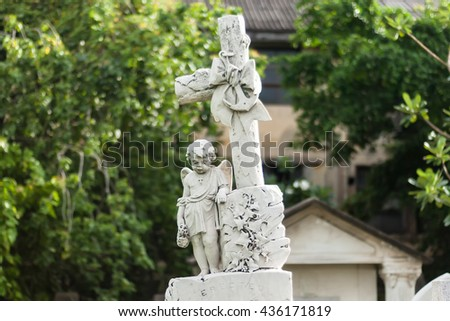 Stone Statue stand in the Old Protestant Cemetery - stock photo