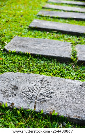 stone step in garden - flora flower design rock walk green grass - stock photo