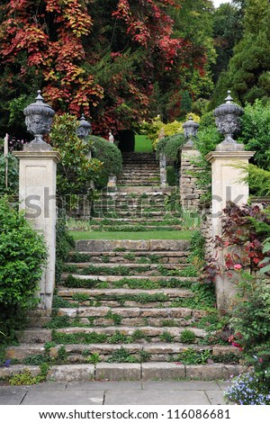Stone Steps in a Peaceful English Landscape Garden - stock photo