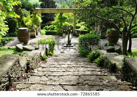 Stone Steps in a Tranquil Landscape Garden - stock photo