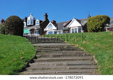 Stone steps leading up from the park to the town - stock photo