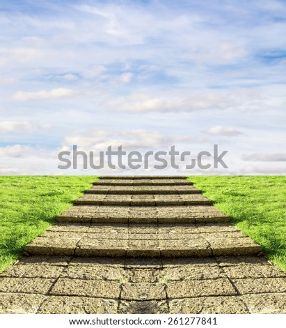 stone steps on the grass in the sky clouds - stock photo