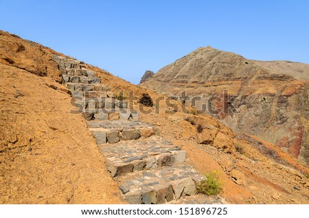 Stone steps on trekking trail at Punta de Sao Lourenco peninsula, Madeira island, Portugal - stock photo
