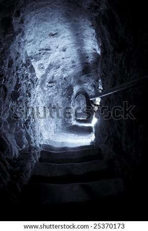 Stone steps to underground, blue toned. - stock photo