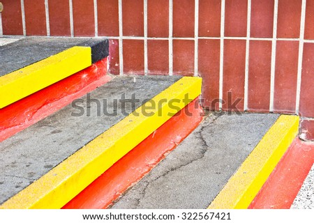 Stone steps with red and yellow lines - stock photo