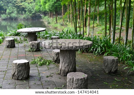 Stone table and chair in the garden