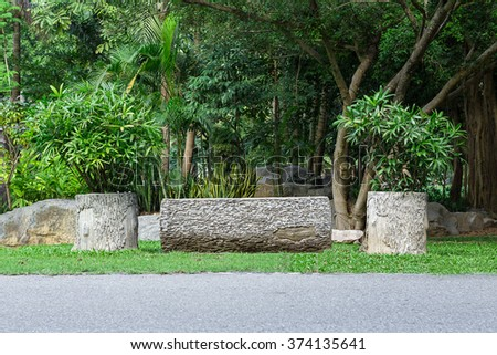 Stone table in the garden - stock photo