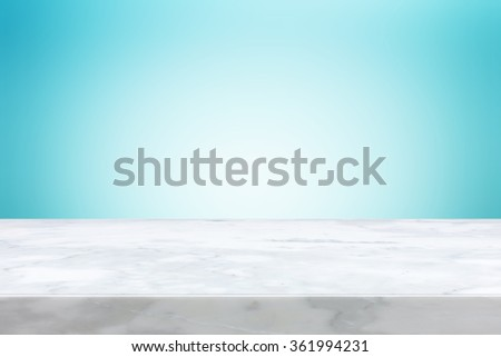 Stone table top on light blue gradient abstract background  - can be used for display or montage your products