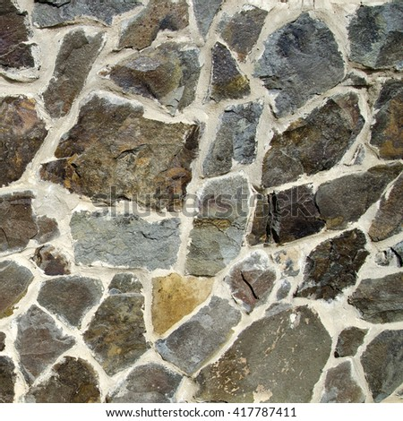 Stone texture wallpaper, different shaped stones - stock photo