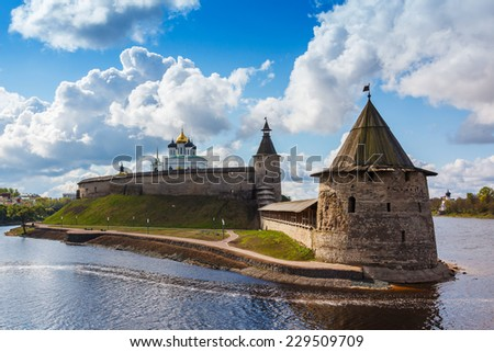 Stone tower and Pskov Kremlin fortress wall at the confluence of two rivers, Russia - stock photo