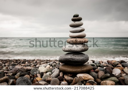 Stone tower on the beach color - stock photo