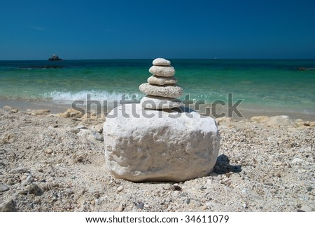 Stone tower with blue sky and sea background - stock photo