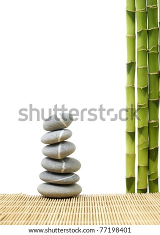 Stone tower with green bamboo grove on bamboo stick straw mat - stock photo