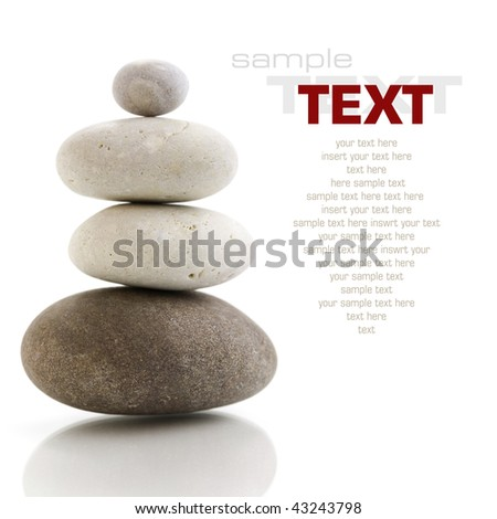 Stone tower with reflection on white background (with sample text) - stock photo