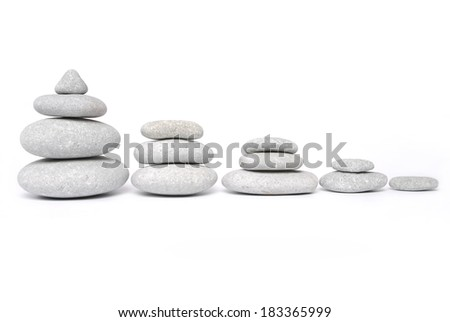 Stone towers isolated on white - stock photo