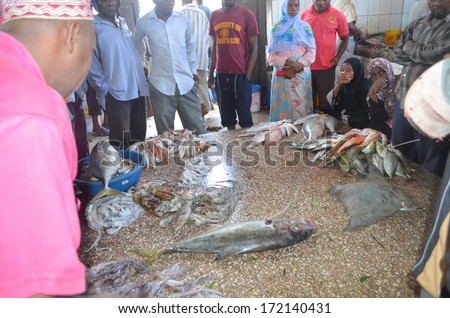 STONE TOWN, ZANZIBAR - DECEMBER 12: Sellers offer fresh fish and seafood in the city market on 12 December 2013 in Stone Town, Tanzania.