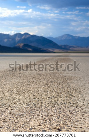 Stone Trace on Racetrack Playa Dry Lake In Death Valley National Park, California.Vertical Image Orientation