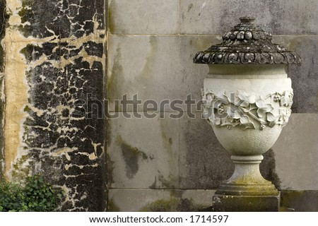 Stone Urn and Wall - stock photo